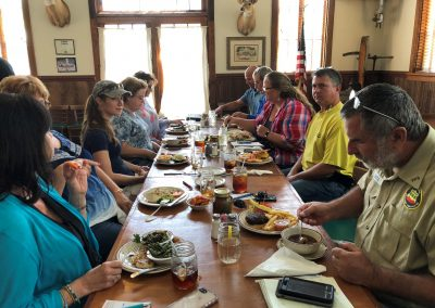 This is a picture of members of the Indian River Lagoon Envirothon planning committee eating lunch at a restaurant before having their meeting.